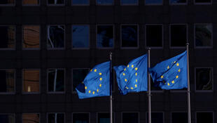 EU flags fly outside the European Commission headquarters in Brussels, Belgium, on February 19, 2020.