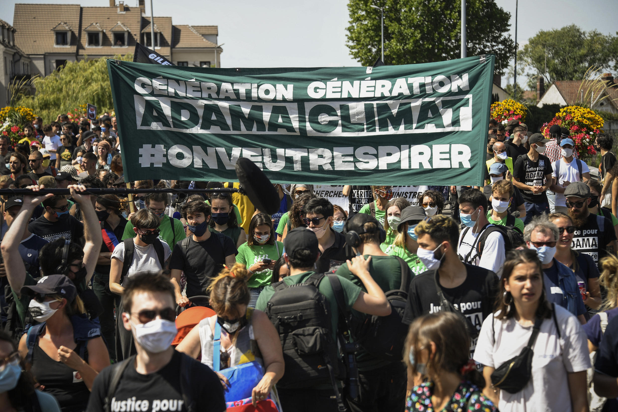Climate activists take part in a rally in the Paris suburb of Beaumont-sur-Oise, on July 18, 2020, marking four years since the death in police custody of black youth Adama Traoré.