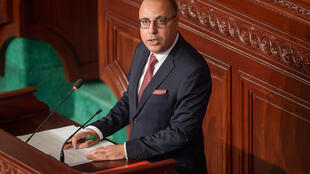 Tunisia's prime minister-designate Hichem Mechichi delivers a speech as parliament readies for a confidence vote