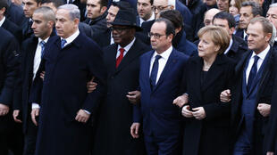 François Hollande (centre) walks at the head of Sunday's unity march in Paris flanked by Malian President Ibrahim Boubacar Keita (left) and German Chancellor Angela Merkel (right).