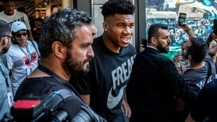 Greek god: Giannis Antetokounmpo drew a crowd for a promotional event in Athens. National team hopes for the World Cup are pinned on the Milwaukee star