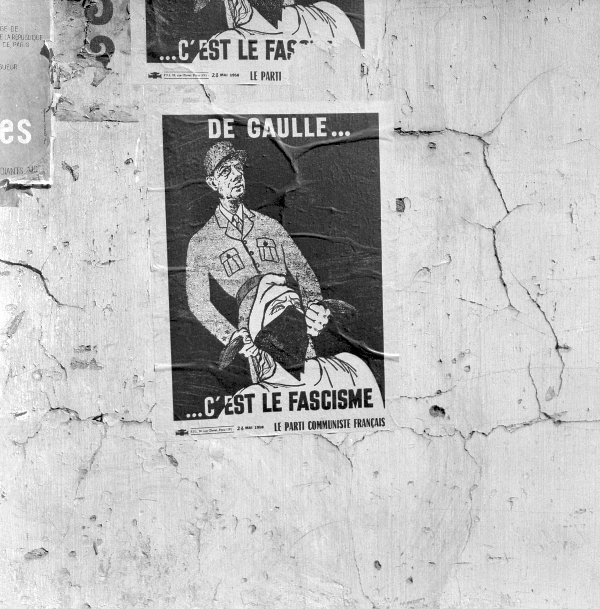 A photo of a poster on a wall in Paris, taken in September 1958. The poster is from the PCF and calls vote no to a referendum on the Constitution of the Fifth Republic proposed by Charles de Gaulle. AFP