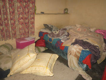 Eight members of the Mahlangu family live in this one-room tenement.