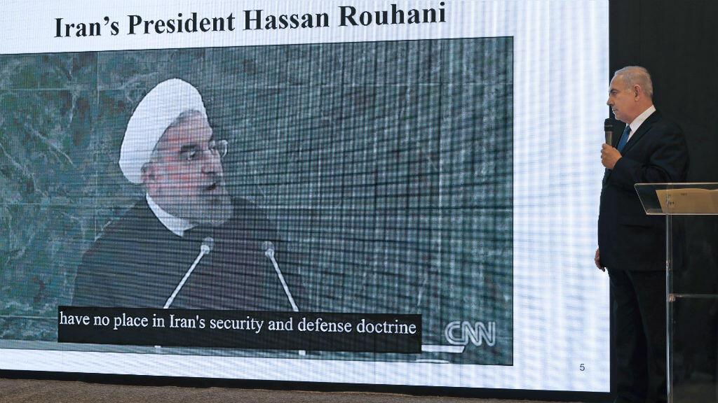 رئيس الوزراء الإسرائيلي بنيامين نتانياهو (يمين)، ورئيس الجمهورية الإسلامية الإيرانية حسن روحاني (يسار)