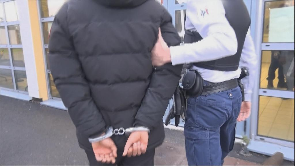 At Paris's Charles de Gaulle airport's administrative detention centre, a man is being escorted by a French police officer. The foreigner is about to be deported back to his home country.