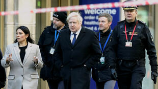 Britain's Prime Minister Boris Johnson, Home Secretary Priti Patel and City of London Police Commissioner Ian Dyson arrive on November 30, 2019, at the scene of a stabbing on London Bridge, where two people were killed a day earlier.