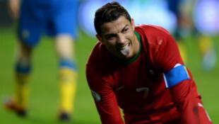 Le Portugais Cristiano Ronaldo, unique buteur, face à la Suède