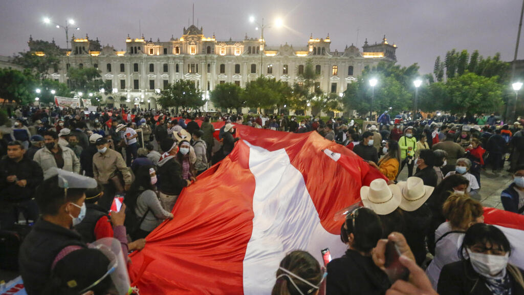 A divided Peru waits for election results as vote count nears completion