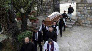 Pallbearers carry the coffin of British radio host Gavin Ford at Mar Sassine Church in Beit Meri, east of Lebanon's capital Beirut, on December 2, 2018