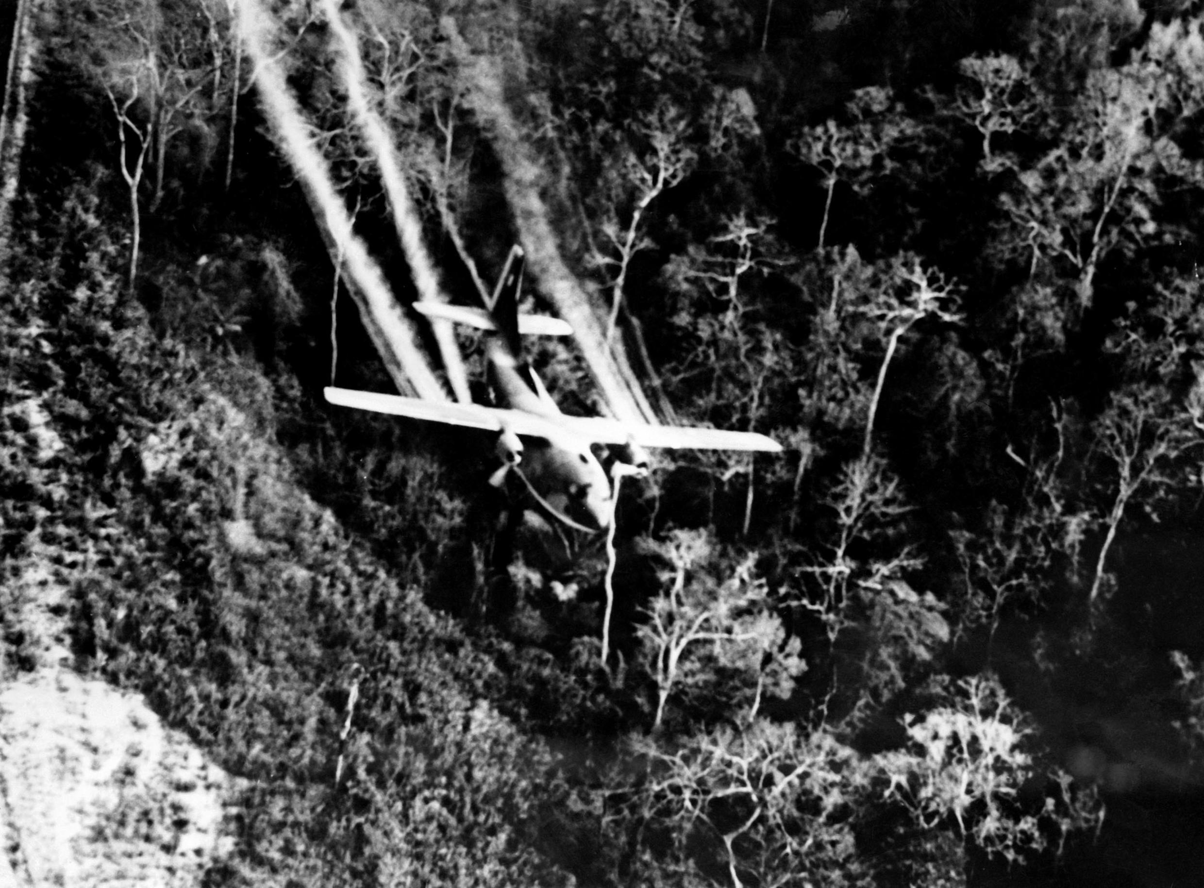 A US Air Force C-123 plane drops Agent Orange on jungle during the Vietnam War on March 3, 1967.