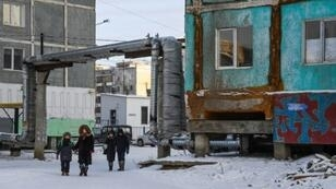 Many houses in Yakutsk are made up of concrete panels and stand on stilts which ensure ventilation of the building's underbelly and prevent it from heating the permafrost, the layer of mineral cemented together with water which is stable as long as it stays frozen. But warmer temperatures are threatening that