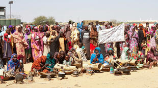 Sudanese internally displaced people stage a sit in to protest against the end of the mandate of the United Nations and African Union peacekeeping mission (UNAMID), in Kalma camp in Nyala, the capital of South Darfur, on December 30, 2020.