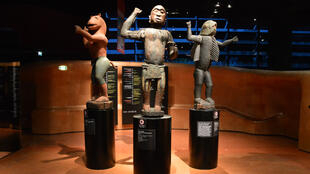 Three large, 19th-century statues from Abomey, Benin on display at the Quai Branly museum in Paris.