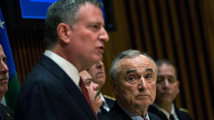 New York Police Department Commissioner Bill Bratton (R) and New York City Mayor Bill de Blasio speak at a press conference regarding two police officers who were killed on Saturday on December 22, 2014 in New York City.