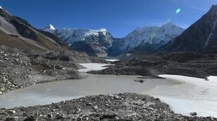 Scientists warn that as Himalayan glaciers melt, lakes like Imja could swell further and eventually collapse
