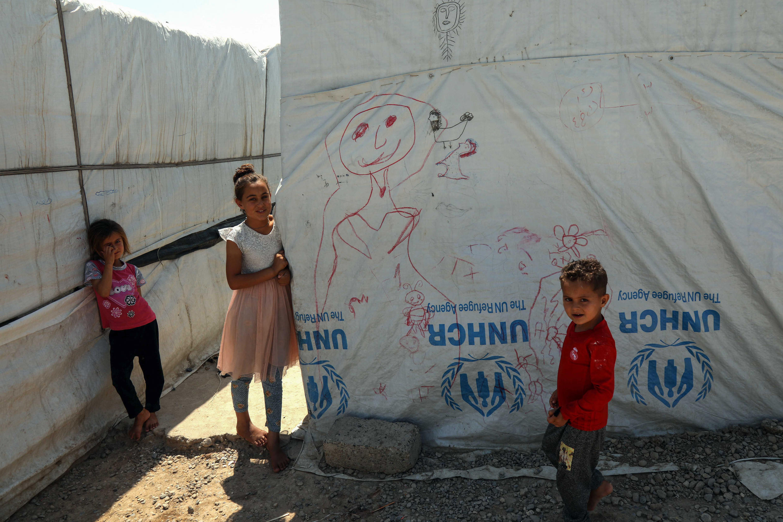 Des enfants yézidis dans un camp de réfugiés à Khanke, proche de la frontière turque, en Irak, le 24 juin 2019.
