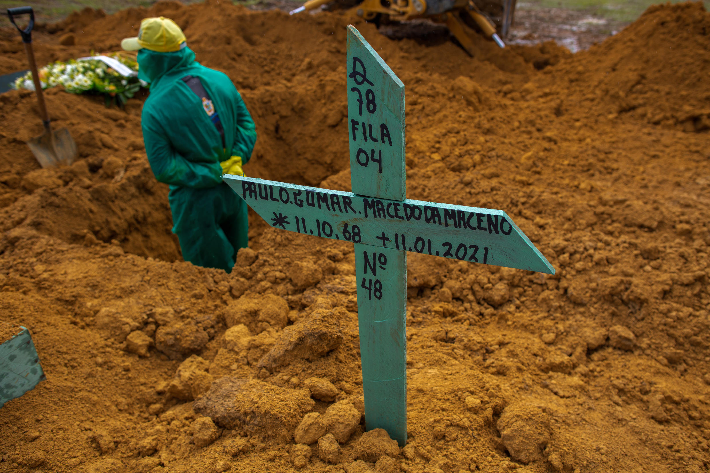 The grave of a Covid-19 victim in Manaus is seen as Brazil records more than 205,000 deaths from Covid-19, second only to the United States