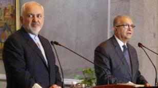 وزير الخارجية الإيراني محمد جواد ظريف ونظيره العراقي محمد علي الحكيم في بغداد 13 يناير/كانون الثاني 2019