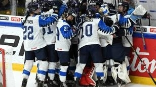 Finland celebrate their win over record 10-time world champions Canada in the semi-final