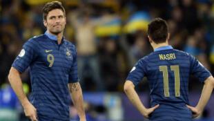Olivier Giroud et Samir Nasri abattus par cette défaite (2-0)