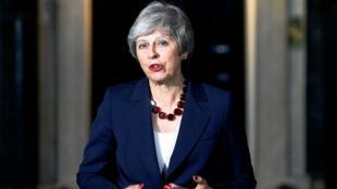 La Première ministre britannique, Theresa May, devant le 10Downing Street à Londres, le 14novembre2018.