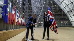 EU Council staff members remove the United Kingdom's flag from the European Council building in Brussels on Brexit Day, January 31, 2020. Britain leaves the European Union at 2300 GMT on January 31, 2020, 43 months after the country voted in a June 2016 referendum to leave the block. The withdrawal from the union ends more than four decades of economic, political and legal integration with its closest neighbours.