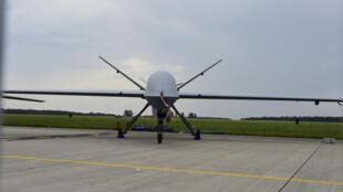 """طائرة مسيرة من طراز """"بريديتر ام كيو-9 في معرض للصناعات الجوية في مدينة شونيفيلد الألمانية في 30 أيار/مايو 2016"""