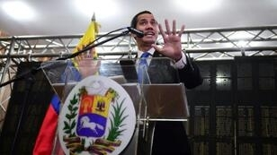 Venezuelan opposition leader and self-declared interim president Juan Guaido talks during a meeting with professionals and technicians at the Caraca's Chamber of Commerce Auditorium, in Caracas on May 16, 2019