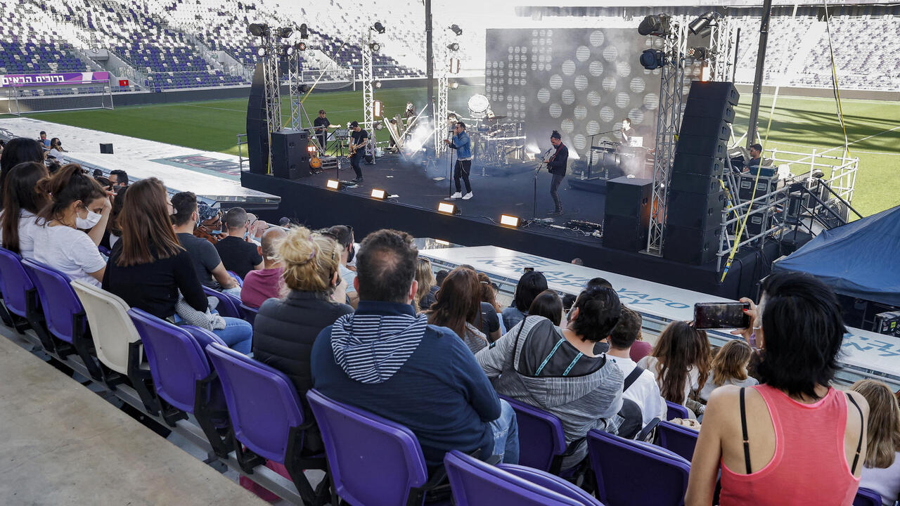 Glimpse of normalcy: Hundreds of vaccinated Israelis attend Tel Aviv concert