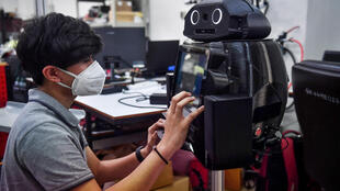 """Thai hospitals are deploying """"ninja"""" robots to measure fevers and protect the health of overburdened medical workers on the frontlines of the coronavirus outbreak"""
