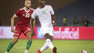 Bance (R) playing for Burkina Faso in an international friendly against Morocco last year