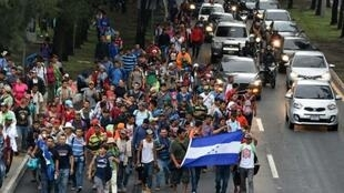 Honduran migrants heading in a caravan to the United States, walk in direction to Tecun Uman -- the border with Mexico -- as they leave Guatemala City, on October 18, 2018