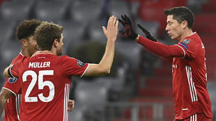 Lewandowski (R) celebrates scoring his 71st Champions League goal in Bayern Munich's win over Salzburg
