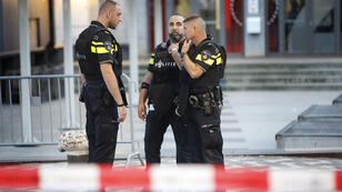 Police stand during the evacuation of the Maassilo concert venue after a concert by Californian band Allah-Las was canceled in relation to a terror attack threat, on August 23, 2017.