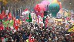 Across France, hundreds of thousands protest pension reform on day one of strike