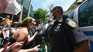 Protesters and police in Brooklyn on 17 June 2020