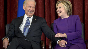Hillary Clinton, seen here in a 2016 file photo with Joe Biden, endorsed the former vice president's White House bid