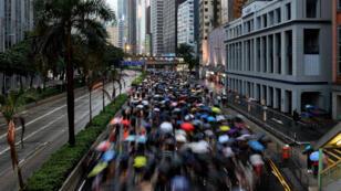 Des manifestants se rassemblent pour exiger des réformes politiques à Hong Kong, le 18août2019.