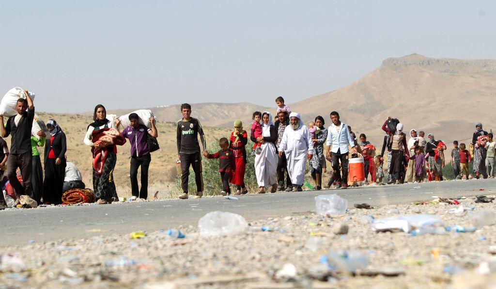 Des milliers de familles irakiennes de la communauté yazidie ont pris la route de l'exode en août 2014, fuyant les violences du groupe État islamique.