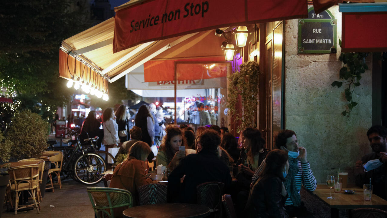 People have drinks on a bar's terrasse in Paris on September 26, 2020, two days before new measures come into effect to curb the spread of Covid-19.