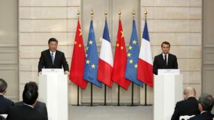 Le président français Emmanuel Macron et son homologue chinois Xi Jinping, le 25 mars 2019, à l'Élysée.