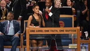 After her performance, Ariana Grande was congratulated by Bishop Charles H. Ellis III, who placed his arm high above her waist with his fingers pressed against her chest