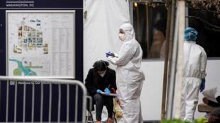 People arrive for testing during the outbreak of coronavirus disease (COVID-19) at George Washington University Hospital in Washington, U.S. April 10, 2020.