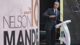 باراك أوباما في مناسبة تكريمية للزعيم الجنوب الأفريقي الراحل نيلسون مانديلا