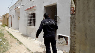A Tunisian gendarme stands guard during a security operation in Ariana province, north of Tunis.