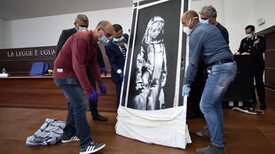 An artwork attributed to Banksy stolen from the Bataclan in Paris in 2019 was found in an abandoned Italian farmhouse
