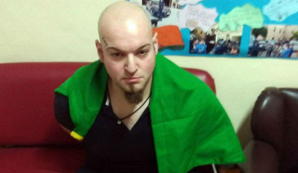 Macerata gunman Luca Traini, 28, pictured on shortly after his arrest on February 3 with an Italian flag still wrapped around his shoulders.