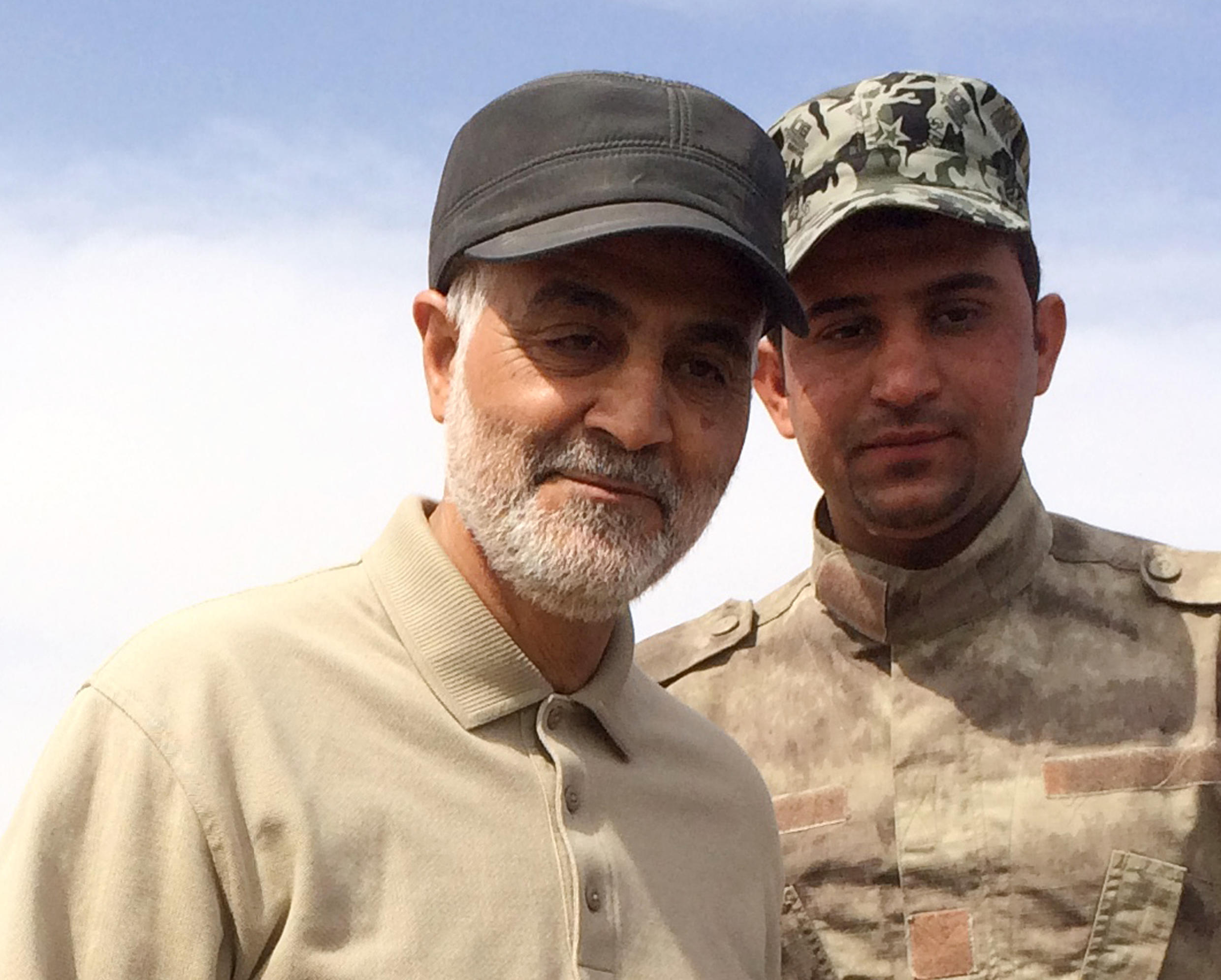 Iranian Revolutionary Guard Commander Qassem Soleimani (L) stands at the frontline during offensive operations against Islamic State militants in the town of Tal Ksaiba in Salahuddin province March 8, 2015. Picture taken March 8, 2015.