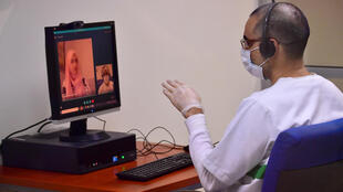 An inmate receives a virtual visit at Dubai's Al-Awir prison in the United Arab Emirates