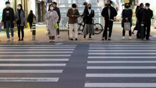مواطنون كوريون يرتدون الكمامات في شوارع مدينة دايغو - كوريا الجنوبية 21/02/2020